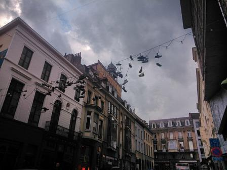 Shoes hanging on a street in Ghent