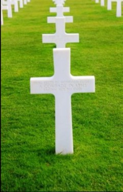 Here rests in honored glory a comrade in arms known but to God. A cross of the many with this message at the American cemetery. Omaha Beach, Normandia